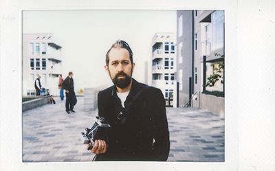 Portrait of the author by MB Moore on Instax Mini